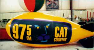 giant advertising blimps - Cat Country logo