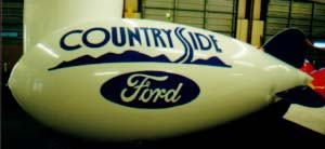 Advertising Blimps - Countryside Ford logo. 14ft. blimps from $665 w/o artwork. 14ft. helium blimps w/artwork or logos from $1021.00.