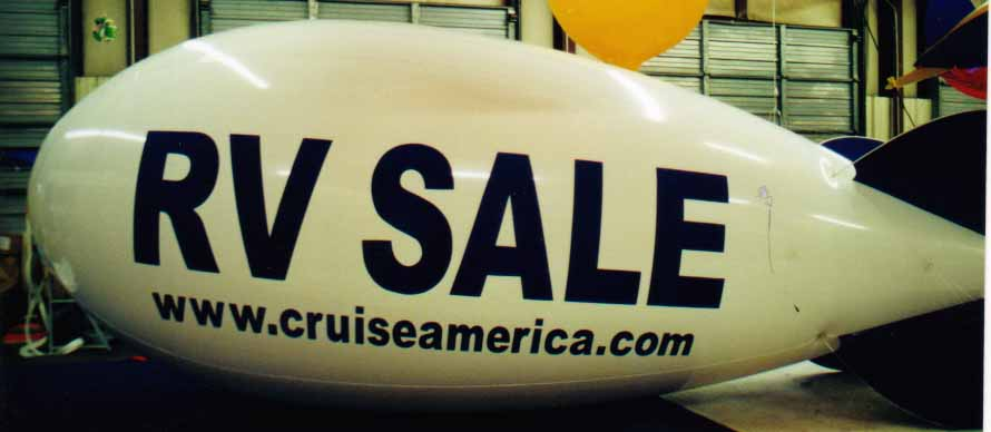 Advertising Blimp - RV SALE logo. Big helium balloons made in the USA.