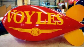 Advertising Blimps - Voyle's logo - we manufacture our helium advertising balloons and helium advertising blimps in the USA.